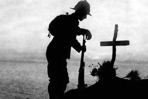 Soldier by a cross in WWI