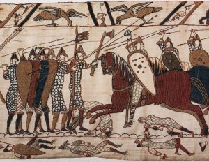 Norman cavalry attacking the English shield wall, from the Bayeux Tapestry