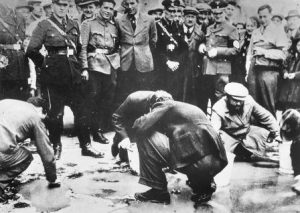 Jews forced to clean the streets of pre-war Vienna.