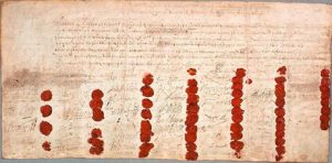 The death warrant of Charles I, showing the seals of the 59 signatories. Many others refused to sign it.